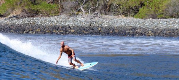 Eric enjoys one of the top 5 surf spots at Costa Rica.